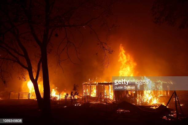 A home burns as the Camp Fire moves through the area on November 8 2018 in Paradise California Fueled by high winds and low humidity the rapidly...