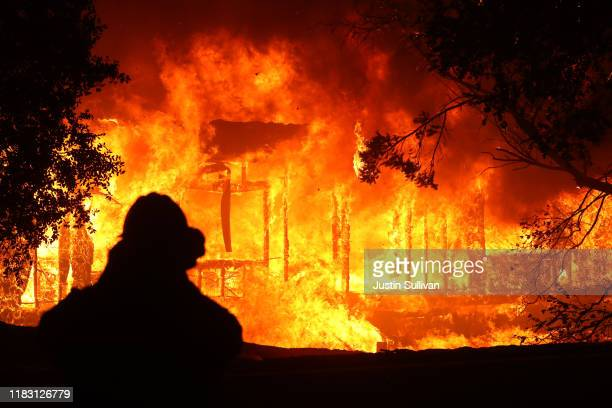 A home burns as the Kincade Fire moves through the area on October 24 2019 in Geyserville California Fueled by high winds the Kincade Fire has burned...