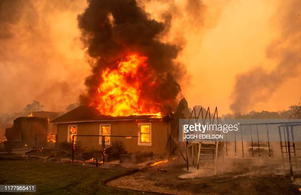 Home burns at a vineyard during the Kincade fire near Geyserville, California on October 24, 2019. - fast-moving wildfire roared through California...