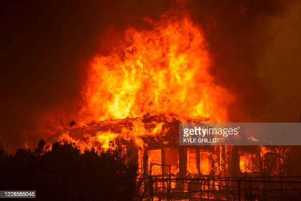 Home burns during the Bobcat Fire in Juniper Hills, California, September 18, 2020. - California faces more devastation from wildfires that have...
