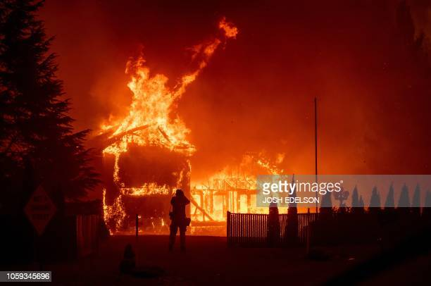 Home burns during the Camp fire in Paradise, California on November 8, 2018. - More than 18,000 acres have been scorched in a matter of hours burning...