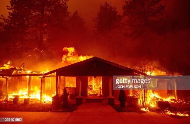 A home burns during the Camp fire in Paradise California on November 8 2018 More than 18000 acres have been scorched in a matter of hours burning...