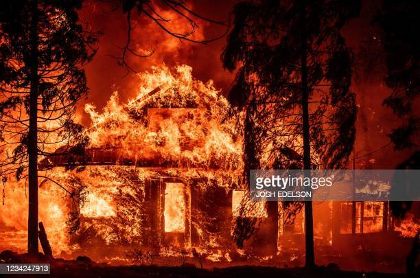 Home burns during the Dixie fire on July 24 in the Indian Falls neighborhood of unincorporated Plumas County, California. - The Dixie fire has now...