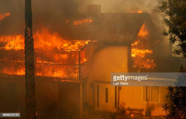 A home burns in the path of the Creek Fire near the intersection of Johanna Avenue and McBroom Street in Shadow Hills on Tuesday Dec 5 2017 The fire...