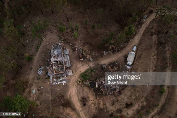 A home burnt by fire is pictured at sunset on January 13 2020 in Wytaliba Australia On the afternoon of November 8 firestorms ripped through the...