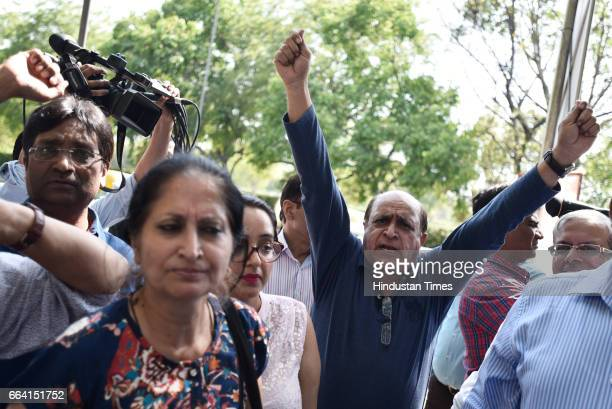 Home buyers shout slogans against Unitech Ltd after Managing Director Ajay Chandra and Sanjay Chandra were brought to Patiala House Court for hearing...