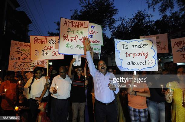 Home buyers took out a candle march against the builder Amarpali group on June 7 2016 in Noida India The Noida authority has called Amarpali group...