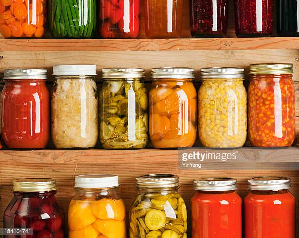 home canning fruit and vegetable food preserves in storage shelves - canned food stock pictures, royalty-free photos & images