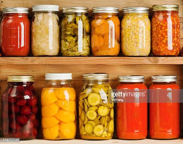 home canning of summer vegetables on wooden shelves hz - pickled stock pictures, royalty-free photos & images