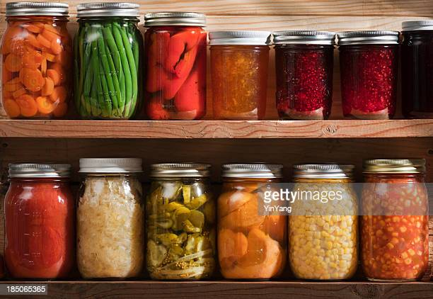 home canning, preserving, pickling food stored on wooden storage shelves - storage compartment stock pictures, royalty-free photos & images