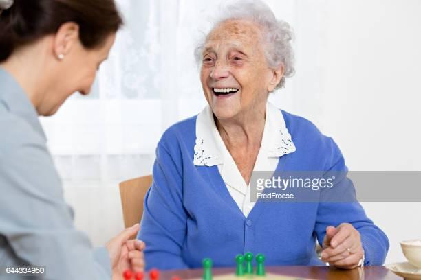 Home caregiver and senior woman