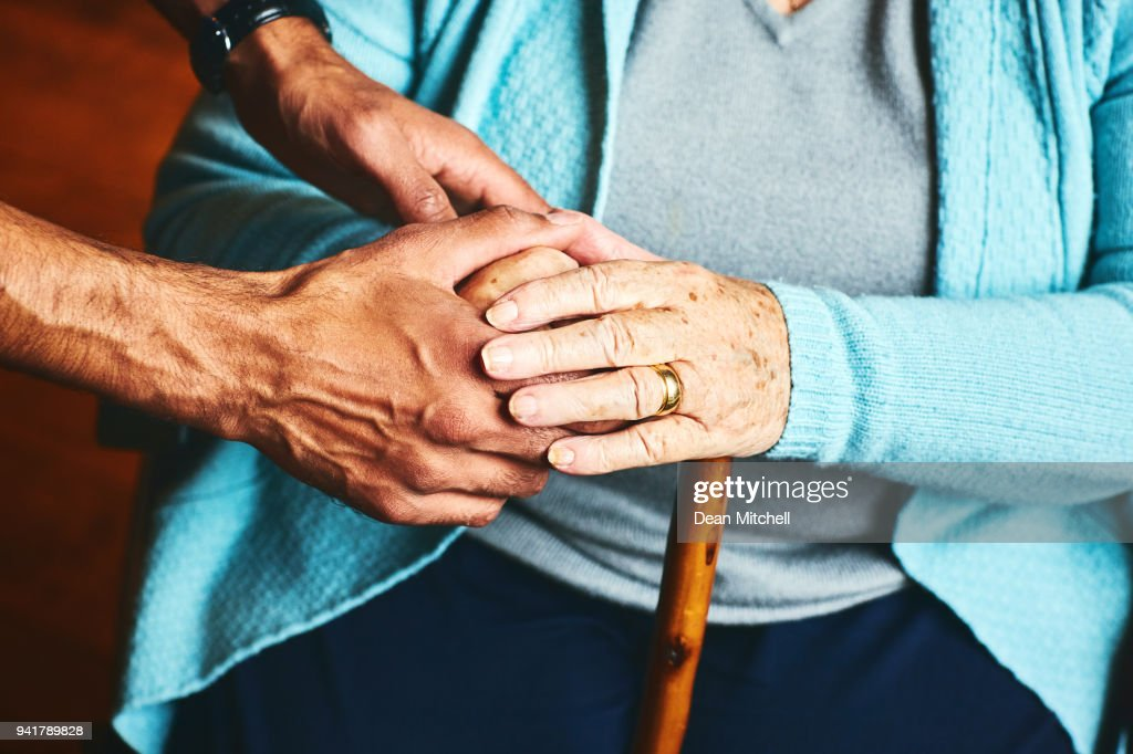 Home caregiver showing support for elderly patient. : Stock Photo