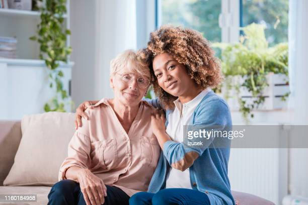 home caregiver with a senior woman - community outreach stock pictures, royalty-free photos & images