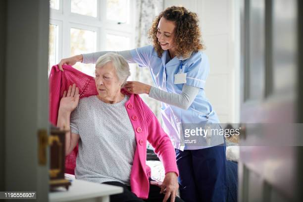 home carer visit - healthcare worker stock pictures, royalty-free photos & images