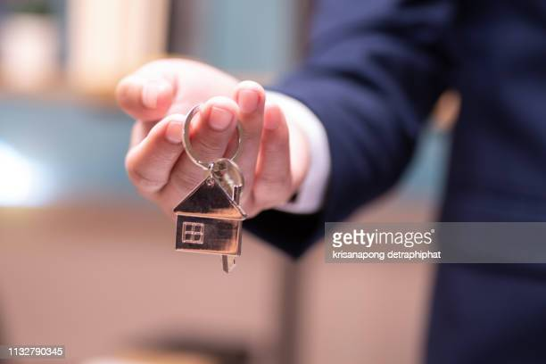 home concept,businessmen holding home keys - datortangent bildbanksfoton och bilder