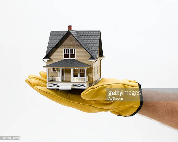 home construction - work glove stock photos and pictures