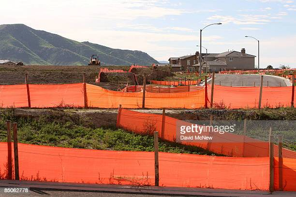 A home construction site stands idle where construction has been halted on February 24 2009 near Riverside California US single family homes prices...