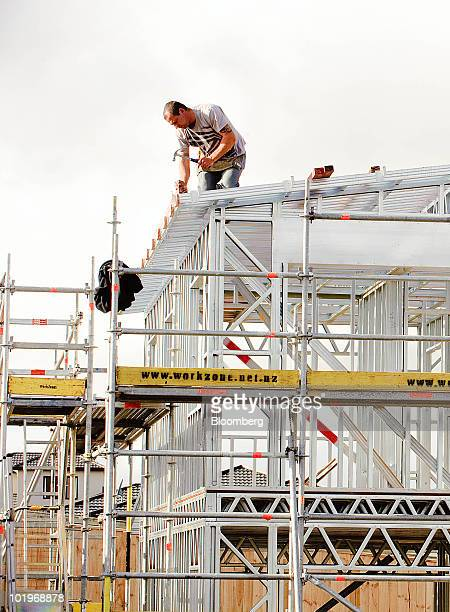 Home construction takes place at a housing development in Aotea near Wellington New Zealand on Friday June 11 2010 New Zealand house prices declined...