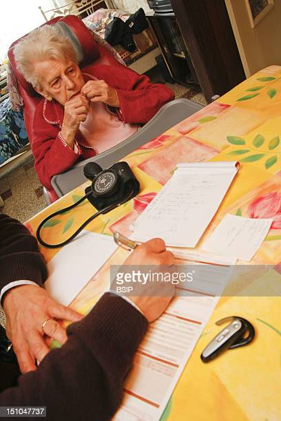 Home Consultation. Merville, France. Consultation At A Disabled Elderly Person's Place.