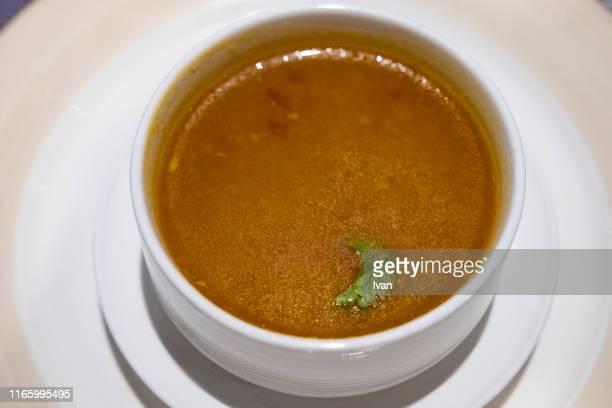home cooked boullion or clear soup in a ceramic bowl - caldo pollo fotografías e imágenes de stock