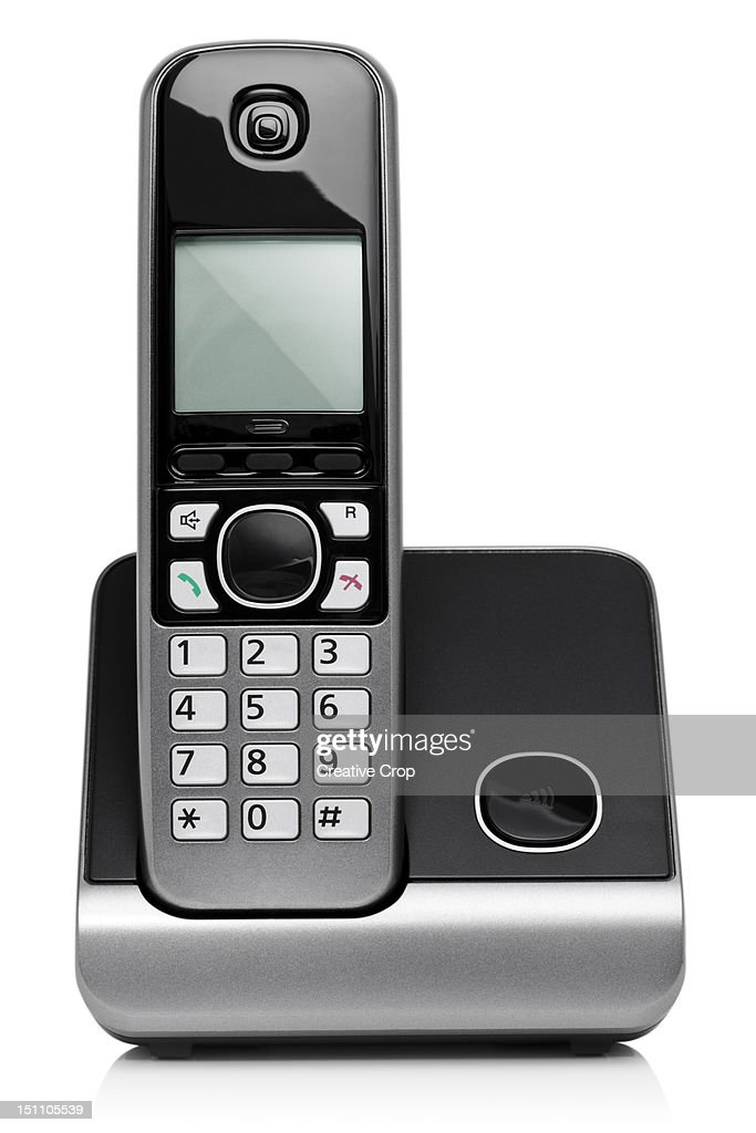 Home cordless digital phone on charging base : Foto stock