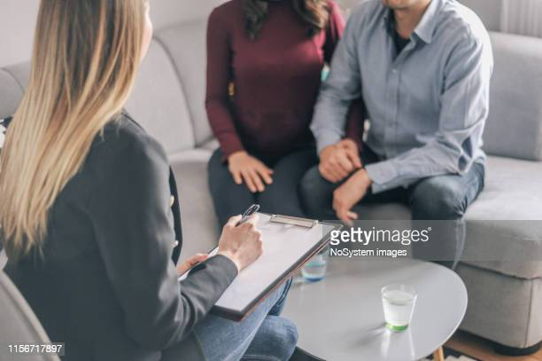home counselling with a young expecting couple with problems - psychotherapy stock pictures, royalty-free photos & images