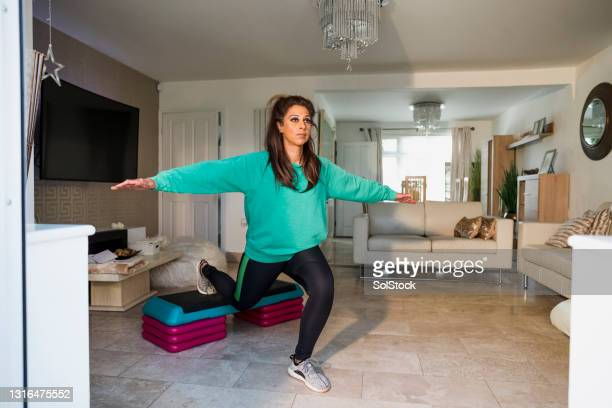 home daily workout - menopossibilities stock pictures, royalty-free photos & images