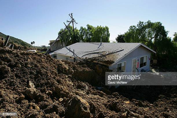 A home damaged in the deadly mudslide that killed at least 10 people is one of those that residents will not be allowed to enter on the first day...