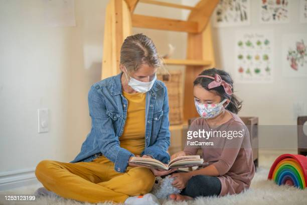home daycare with masks - fatcamera stock pictures, royalty-free photos & images
