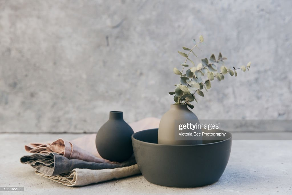 Home decor - neutral coloured vases and dish-ware and linen napkin in nordic style against grey wall. : Stock-Foto