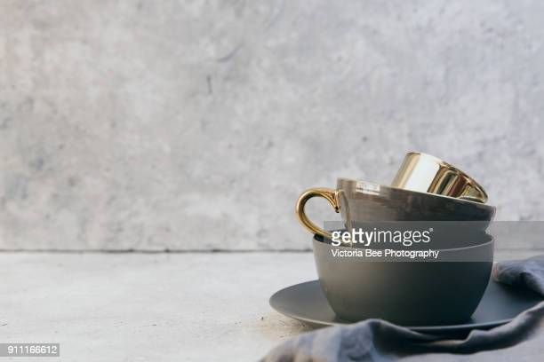 home decor - neutral coloured vases and dish-ware and linen napkin in nordic style against grey wall. - keukengereedschap stockfoto's en -beelden