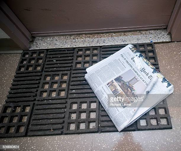 A home delivery copy of the New York Times in front of an apartment door contains the first frontpage editorial the Times has run since 1920 The...