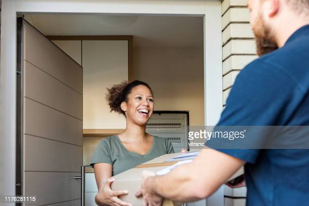 home delivery of a box to the client - receiving stock pictures, royalty-free photos & images