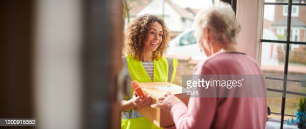 home delivery - receiving stock pictures, royalty-free photos & images