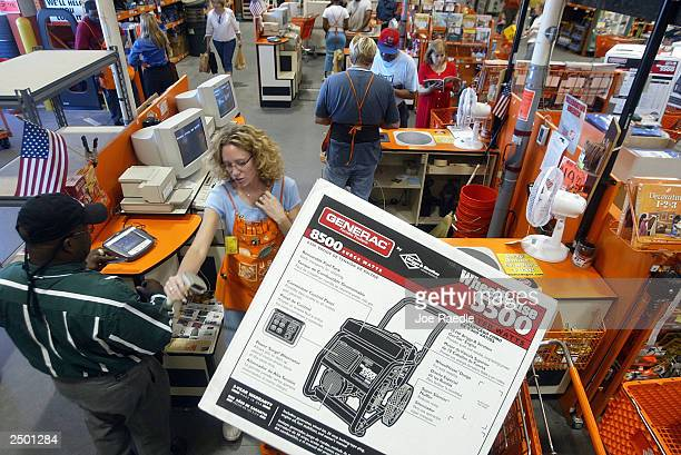 Home Depot cashier Shelly Fahrner rings up a customer purchasing a generator in preparation for Hurricane Isabel September 16 2003 in Virginia Beach...