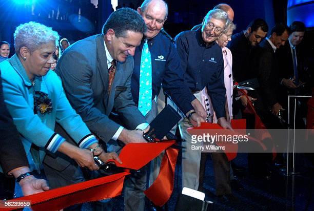Home Depot cofounder Bernie Marcus Georgia Governor Sunny Perdue Air Tran COO Bob Fornaro Atlanta Mayor Shirley Franklin cut the opening ribbon to...