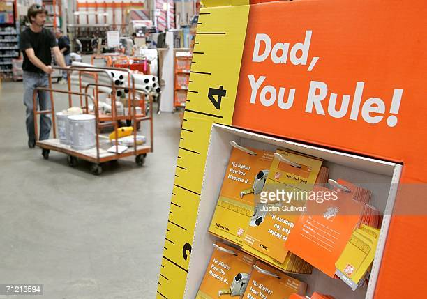 Home Depot customer walks by a display of Father's Day gift cards at a Home Depot store on June 15 2006 in San Rafael California Retail outlets are...
