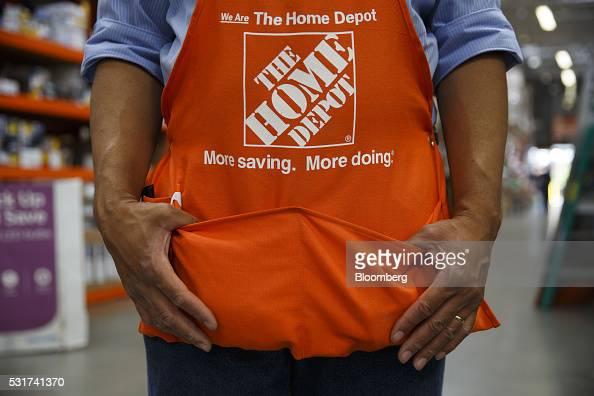 Home Depot Inc Signage Is Displayed On The Apron Of An Employee At News Photo Getty Images