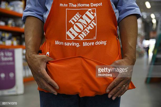 Home Depot Inc signage is displayed on the apron of an employee at the company's store in Torrance California US on Friday May 13 2016 Home Depot is...
