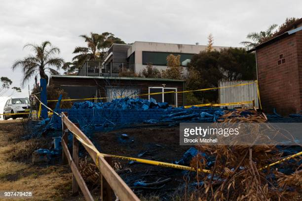 A home destroyed by fire is covered in blue asbestos retardent on March 25 2018 in Tathra Australia A bushfire which started on 18 March destroyed 65...