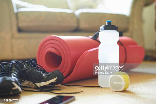 home exercise equipment in a living room - sports stock pictures, royalty-free photos & images