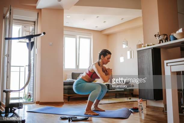 home exercising - crouching stock pictures, royalty-free photos & images