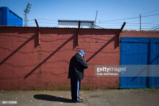 A home fan pauses outside the turnstiles outside Palmerston Park Dumfries before Queen of the South hosted Dundee United in a Scottish Championship...