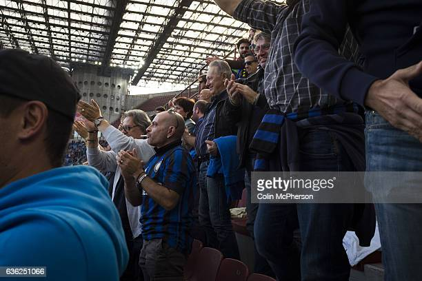 Home fans celebrating Joao Mario's 55th minute goal at the Stadio Giuseppe Meazza also known as the San Siro as Internationale took on Cagliari in an...