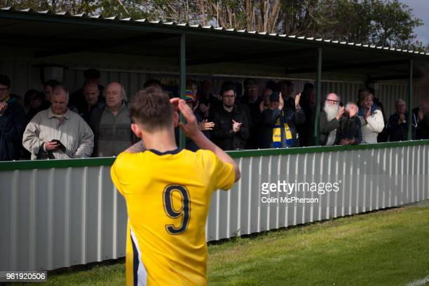 Home fans in the Tin Shed applauding their team from the pitch at Mount Pleasant after Marske United take on Billingham Synthonia in a Northern...