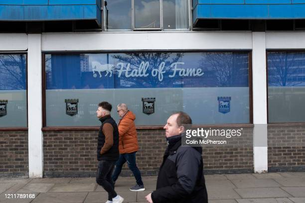 Home fans making their way to the stadium before Ipswich Town play Oxford United in a SkyBet League One fixture at Portman Road Both teams were in...