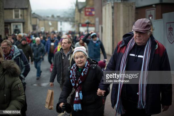 Home fans making their way towards the stadium before Burnley hosted Everton in an English Premier League fixture at Turf Moor Founded in 1882...