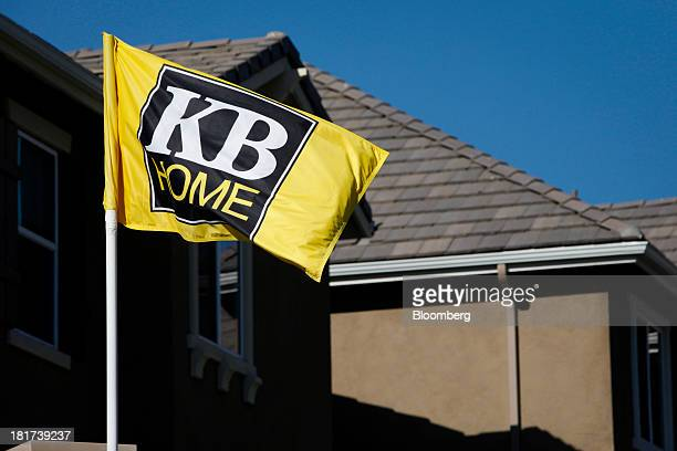 Home flag stands in front of a house at the Whisler Ridge housing community in Lake Forest, California, U.S., on Monday, Sept. 23, 2013. KB Home, a...
