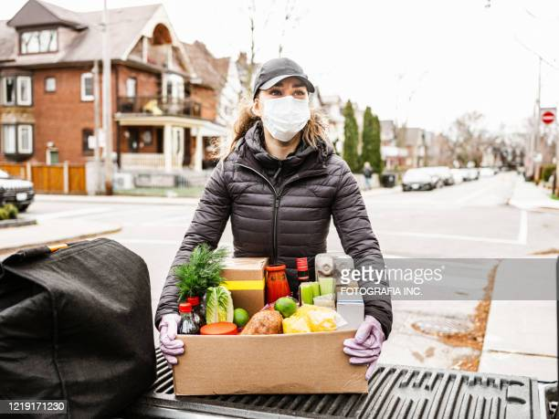 covid-19, home food delivery during lockdown - ontario canada stock pictures, royalty-free photos & images