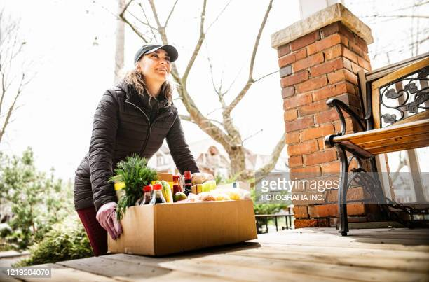 covid-19, home food delivery during lockdown - positive emotion stock pictures, royalty-free photos & images